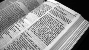 Black and white picture of New Jerusalem Bible open at the passage for the circumcision of John the Baptist