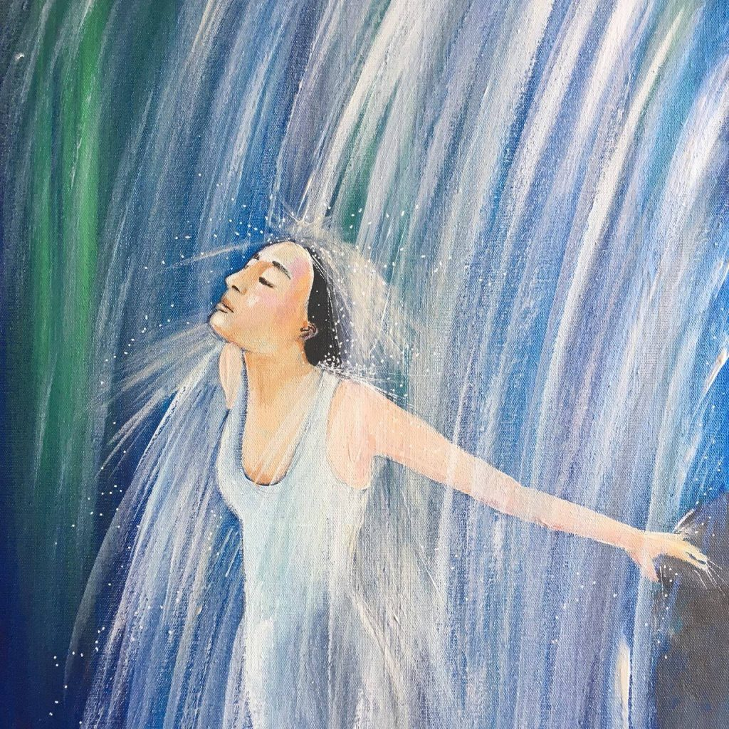 Painting by artist Helen Yousaf. A slender woman stands in a white dress underneath falling water. Her face looks peacefully up and outward, with her eyes closed as she stretches are arms outwards behind her to feel the water. The water splashes against her dark hair. Hues of blue, turquoise, green and white.
