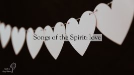 String of white paper hearts against a black background with the words: Songs of the Spirit: love